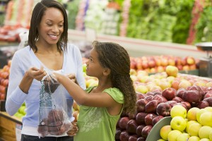 bigstockphoto_woman_and_child_choosing_fruit_39154651