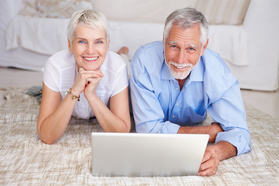 bigstockphoto_happy_senior_couple_lying_down_4902020