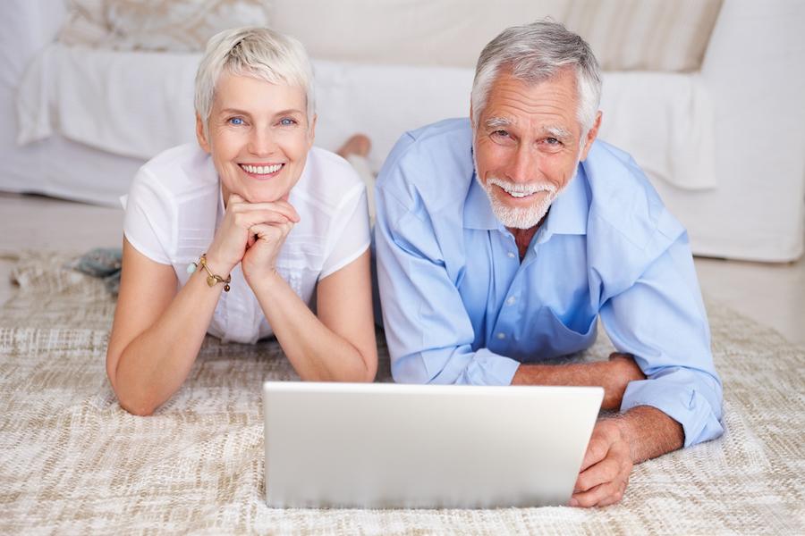 bigstockphoto_happy_senior_couple_lying_down_4902020