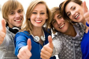 bigstockphoto_teens_with_thumbs_up_6006256