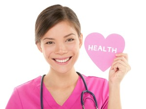 Medical nurse doctor woman showing HEALTH sign on heart. Health