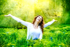 Beautiful Young Woman Outdoors. Enjoy Nature. Healthy Smiling Gi