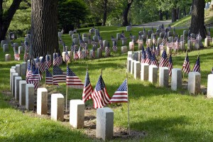 Memorials in Cemetery with American Flags