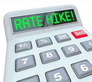 Rate Hike words in green letters on a calculator display to illu