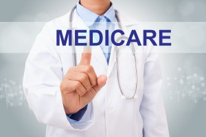 Doctor hand touching MEDICARE sign on virtual screen. medical co