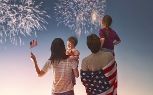 Patriotic holiday. Happy family, parents and daughters children