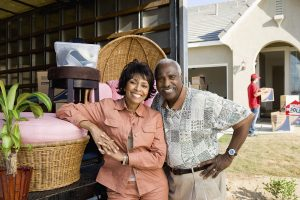 Portrait of happy African American couple moving to their new ho