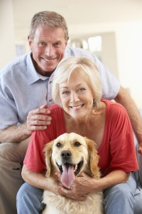 Retired couple at home with dog