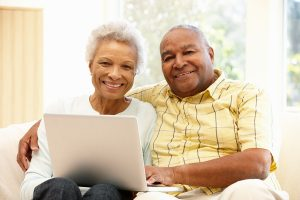 Senior African American couple using laptop